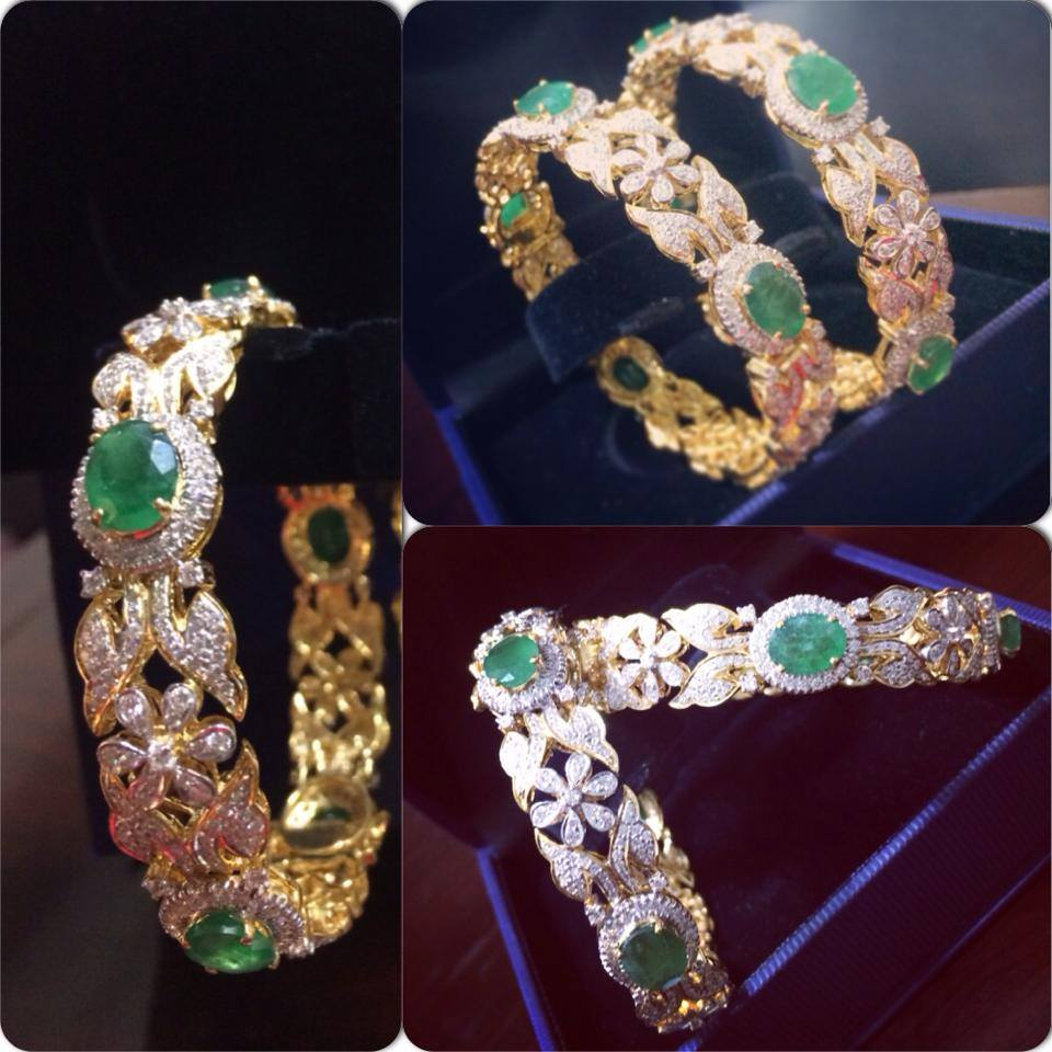 gold to emerald in pair of ruby zoom set hover bangles