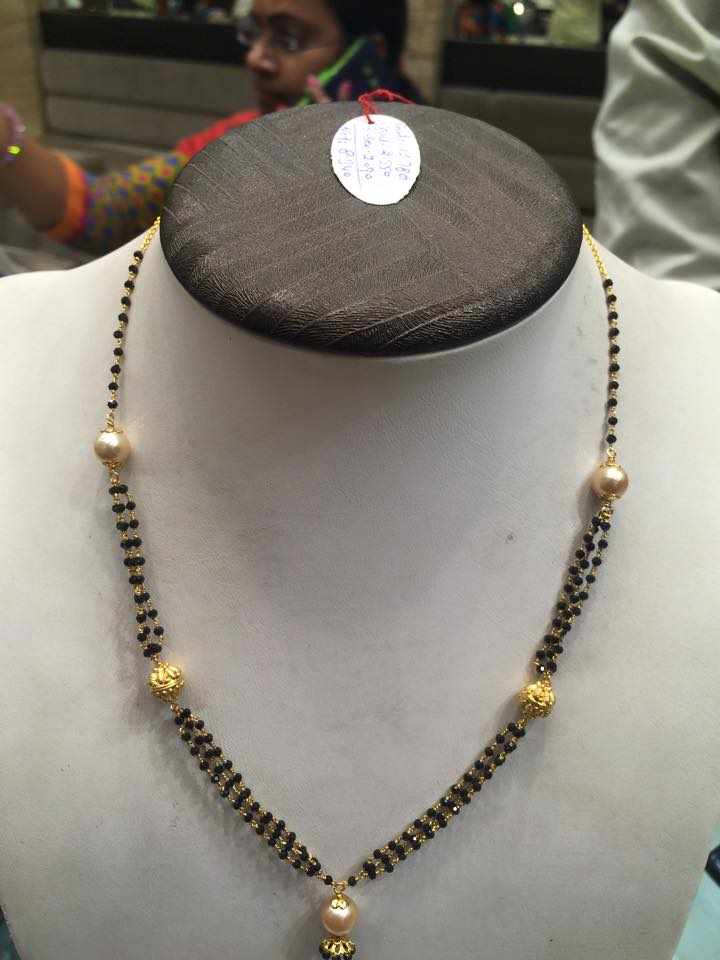black spinal beads