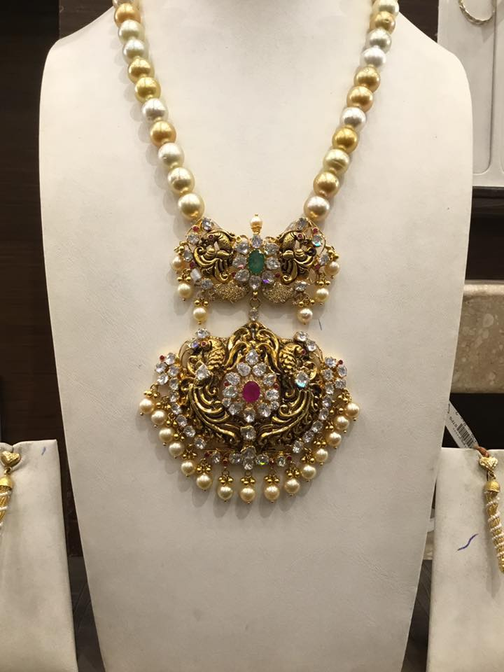 south sea pearl chain with antique pendant