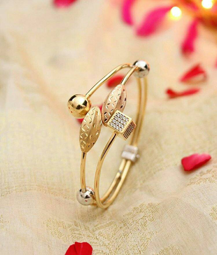 Gold Fancy Bangles Collection Boutiquedesignerjewellery Com